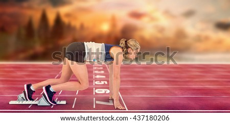 Composite image of female athlete in position ready to run on race track - stock photo