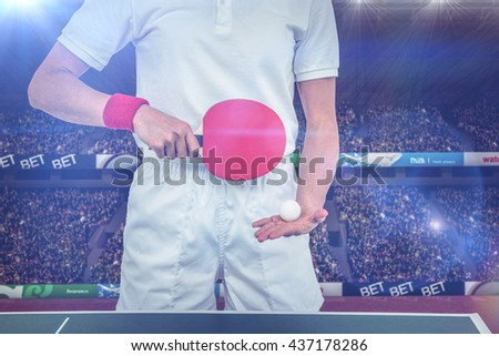 Composite image of female athlete playing table tennis in a stadium - stock photo