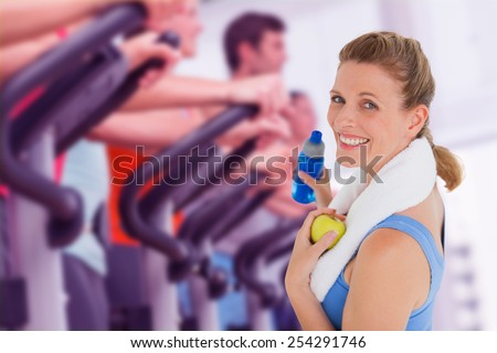 Composite image of fit woman smiling at camera - stock photo