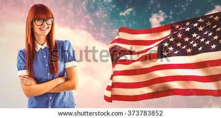 Composite image of gorgeous smiling red haired hipster beside american flag - stock photo