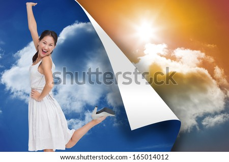 Composite image of happy and classy brunette posing - stock photo