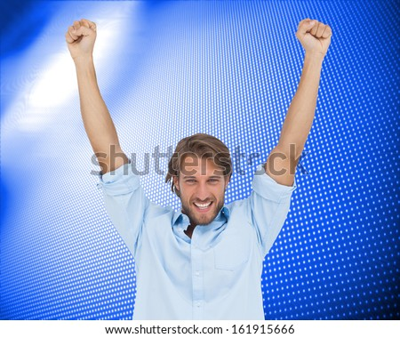 Composite image of happy man celebrating success with arms up  - stock photo