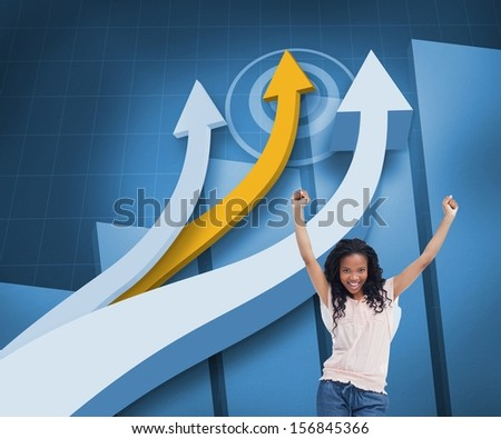 Composite image of happy woman with her arms raised up in front of arrows and statistic on blue background