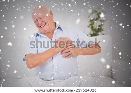 Composite image of old man suffering with heart pain against snow falling - stock photo