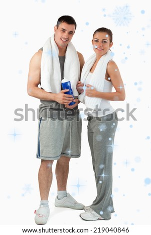 Composite image of Portrait of a couple going to practice sport with snow falling - stock photo