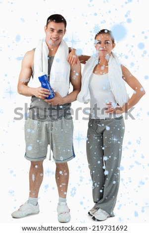 Composite image of Portrait of a young couple going to practice sport with snow falling - stock photo