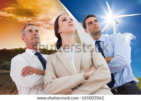 Composite image of serious work team posing together looking away - stock photo