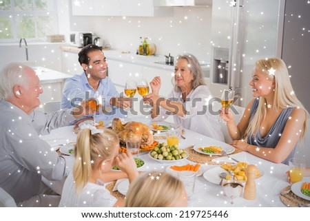 Composite image of Smiling adults raising their glasses against snow - stock photo