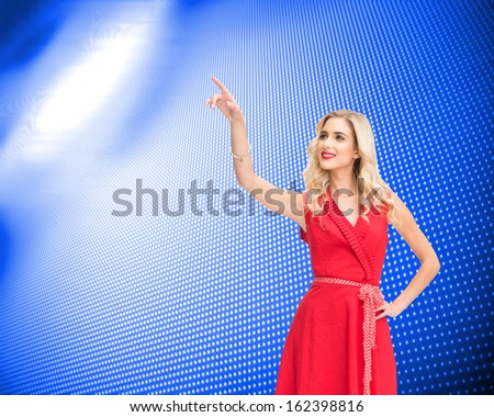 Composite image of smiling attractive blonde pointing - stock photo