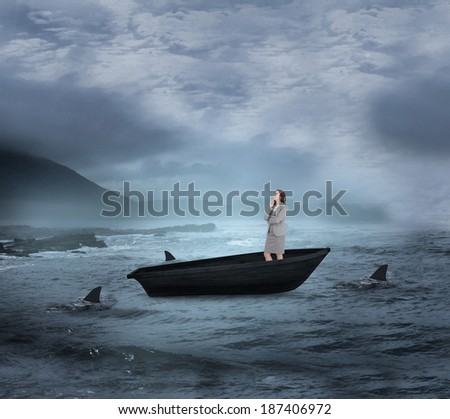Composite image of smiling thoughtful businesswoman in a sailboat being circled by sharks