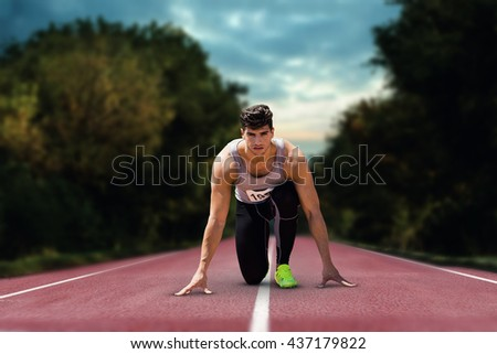 Composite image of sportsman waiting on the starting line on athletics field - stock photo