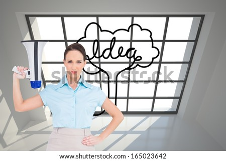 Composite image of stern classy businesswoman holding megaphone while posing