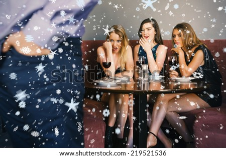 Composite image of Three friends checking out mans rear against snow - stock photo