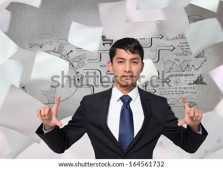 Composite image of unsmiling businessman holding - stock photo