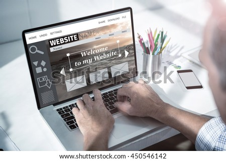 Composite image of website interface against overhead of masculine hand typing on laptop - stock photo