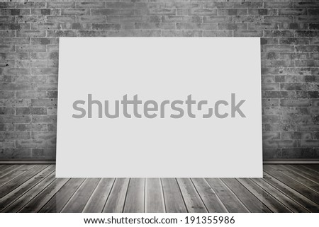 Composite image of white card against grey room
