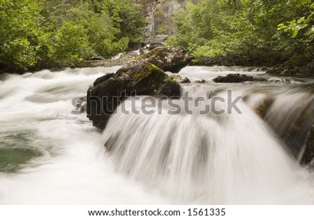 Composite image (4 originals) of Liberty falls cascade flow downstream from main waterfall - stock photo