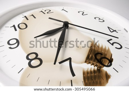 Composite of Wall Clock and Light Bulbs - stock photo