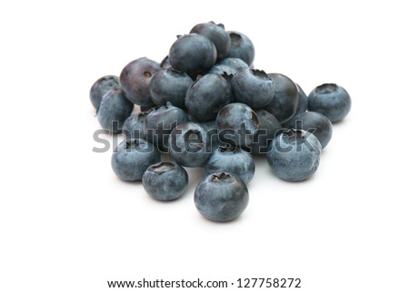 composition from a fresh bow whortleberry on the white isolated background