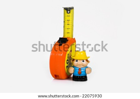 Composition from a toy figure of the worker and meter - stock photo