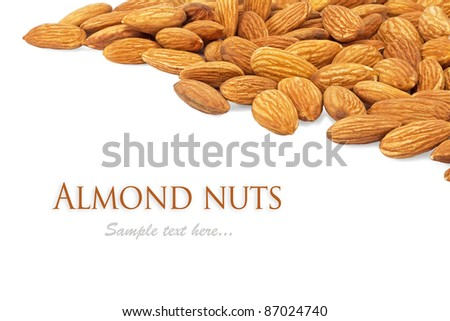composition from almond nuts on white backgrounds - stock photo