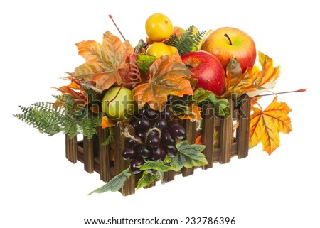 Composition from Artificial Fruits and Autumn Leaves in Wooden Box Isolated on White Background. - stock photo