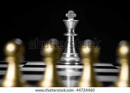 Composition from chessmen on a black background - stock photo