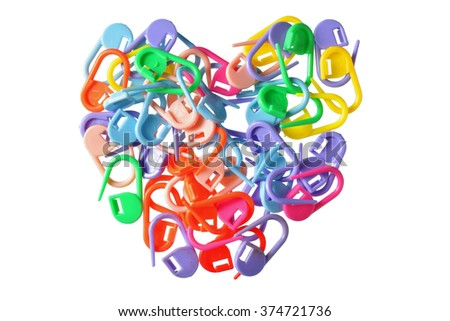 composition in a heart-shaped multi-colored pins