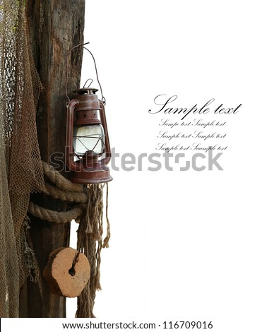 composition is marine consisting of an old lamp, rope and fishing net isolated in white - stock photo