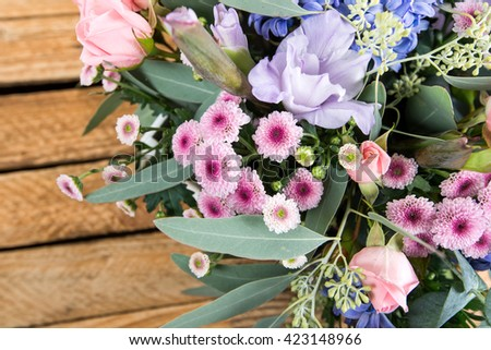 composition of a bouquet of flowers on a wooden background, retro style - stock photo