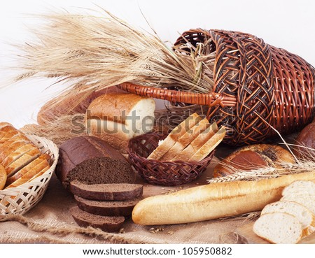 composition of bread and wheat spikelets - stock photo