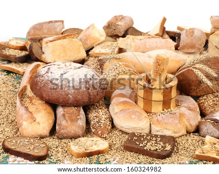 Composition of breads and wheat. On a white background