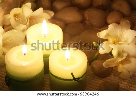 composition of candles and freesias in dark - stock photo