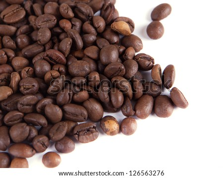 composition of coffee beans on a white background - stock photo