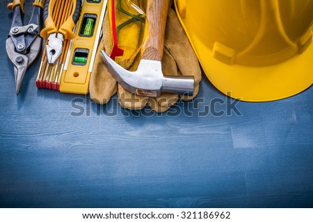 Composition of construction tools on wooden board horizontal view. - stock photo