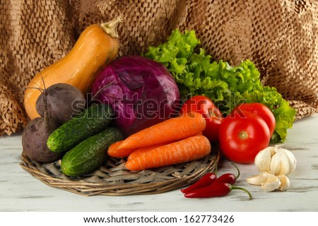 Composition of different vegetables on table on brown background