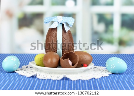 Composition of Easter and chocolate eggs on window background - stock photo