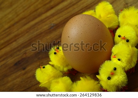 Composition of Easter egg and yellow chicks - stock photo