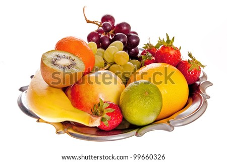 Composition of fresh fruit on the decorative metal tray.