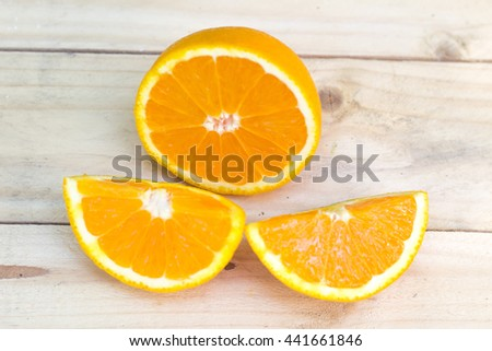 Composition of fresh ripe cut oranges on wooden background. Exotic juicy mellow fruit