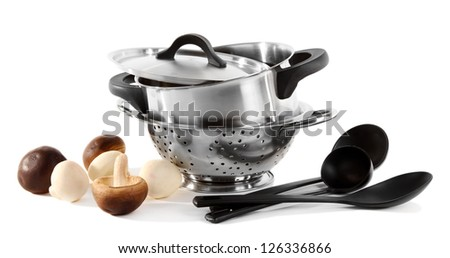 composition of kitchen tools and mushrooms isolated on white