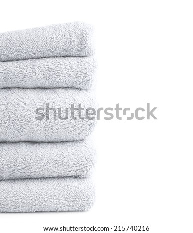 Composition of multiple white terry cloth bath towels in a pile against the white background - stock photo