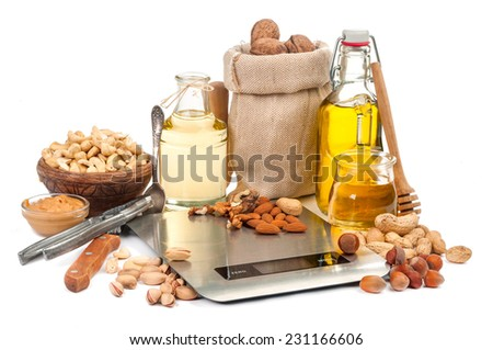composition of nuts and scales isolated on white background - stock photo