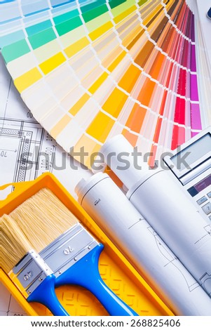 composition of painting tools paint brushes blueprints color palette  - stock photo