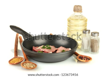 composition of raw meat and spices on white background close-up - stock photo
