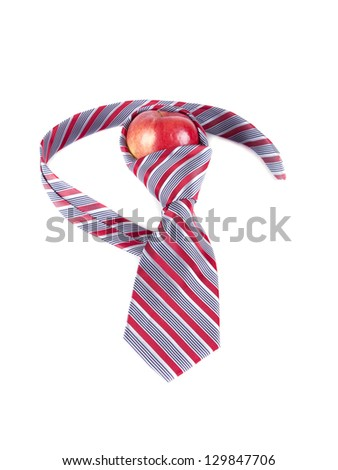 composition of red apple and a red tie on a white background - stock photo
