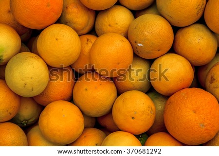 Composition of several oranges on a white backround - stock photo