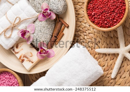 Composition of spa accessories in pink and red tone; wellness, massage - stock photo