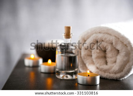 Composition of spa treatment on table colorful background - stock photo