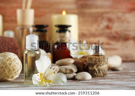 Composition of spa treatment on wooden background - stock photo